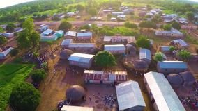 Apocalyptic scene when people are running in Africa. NIn a village in northern Africa, people are fleeing to see a helicopter landing.They all are courious to stock footage