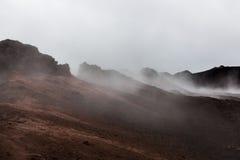Apocalyptic smoking red landscape of Krafla. Apocalyptic smoking red landscape of Krafla crater. Red lava hills - still active volcanic area near Myvatn, North royalty free stock photos