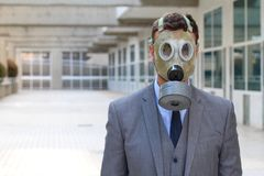 Apocalyptical image of businessman wearing gas mask.  royalty free stock photos