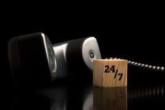 24-7 apoio e auxílio do telefone Imagens de Stock