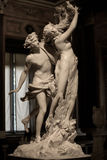 Apollo and Daphne by Gian Lorenzo Bernini. Apollo and Daphne is a life-sized Baroque marble sculpture by Italian artist Gian Lorenzo Bernini. Daphne turning royalty free stock photo