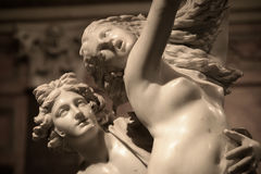 Apollo and Daphne by Gian Lorenzo Bernini. Apollo and Daphne is a life-sized Baroque marble sculpture by Italian artist Gian Lorenzo Bernini. Daphne turning royalty free stock image