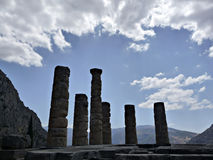 Apollo Delphy. Ruins of Apollo temple at Delphy at sunny summer day agains cloudy sky Royalty Free Stock Photography