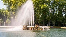 Apollo fountain in summer with water play. The Apollo fountain in Versailles garden in summer with water display Royalty Free Stock Photos