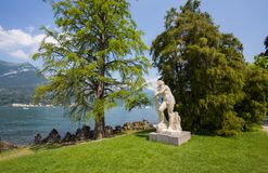 Apollo statue in the Gardens of Villa Melzi in the village of Bellagio on Como lake, Italy royalty free stock photography