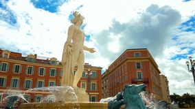 Apollo statue with Sun fountain on Massena Place, history and culture of France. Stock photo stock image