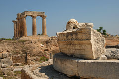 Apollo Temple, Corinth. A view of the ruins of the ancient Apollo temple in Corinth (Korinth). The focus is on a piece of ruins with some words inscribed on it royalty free stock photography