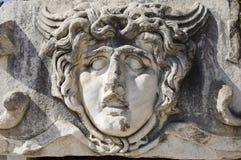 Apollo Temple Medusa sculpture. Close up of ancient sculpture of Medusa in Temple of Apollo, Didim, Turkey Stock Photos