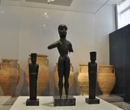 Minoan Archaeological Museum interior from Heraklion in Crete island. Apollonian Triad small Statues from Temple Apollo at Dreros from 8th century BC in the royalty free stock photos
