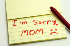 Apologies. A handwritten notes with sorry message Stock Images