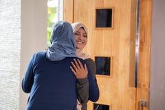Apologizing to her mother during eid mubarak celebration royalty free stock photo