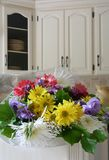 The apology. Bouquet of flowers in a country kitchen Royalty Free Stock Photo