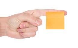 Apontando a mão com etiqueta no dedo Fotos de Stock Royalty Free