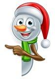 Apontando o Natal Santa Hat Snowman dos desenhos animados Fotografia de Stock