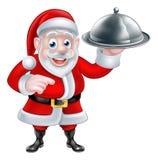 Apontando Santa Chef Holding Christmas Dinner Fotos de Stock