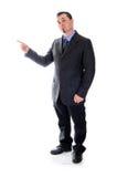 Apontar à esquerda Homem no terno Imagem de Stock Royalty Free