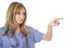 Apontar da enfermeira isolado no branco Fotos de Stock