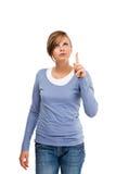 Apontar da mulher isolado no fundo branco imagem de stock