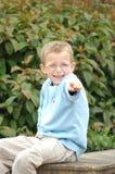 Apontar de sorriso do menino Imagem de Stock Royalty Free