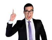 Apontar engraçado do homem de negócio acima Foto de Stock