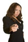 Apontar irritado da mulher de negócios foto de stock
