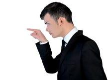 Apontar irritado do homem de negócio foto de stock