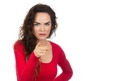 Apontar irritado irritado da mulher Imagem de Stock