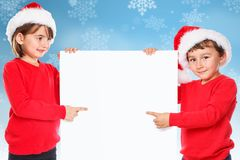 Apontar nevando de Santa Claus do Natal das crianças das crianças olhando o emp fotos de stock