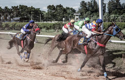 Aposta do jogo da corrida de cavalos Fotografia de Stock Royalty Free