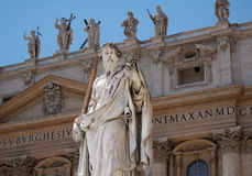 Apostle. Statue of apostle Paul in front of facade of Saint Peter's Basilica in Vatican, Italy Stock Images