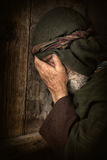 Apostle Peter in shame and repentance. After having denied knowing Jesus before the cock crows three times Stock Photos