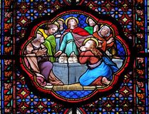 Apostles before empty tomb of Virgin Mary. Stained glass window in the Basilica of Saint Clotilde in Paris, France stock photos