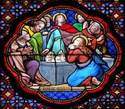 Apostles before empty tomb of Virgin Mary. Stained glass window in the Basilica of Saint Clotilde in Paris, France royalty free stock photography