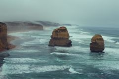 12 Apostles. Morning fog creeping over the cliffs at the 12 Apostles - Great Ocean Drive, Australia Royalty Free Stock Image