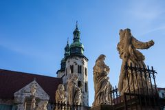 Apostles Sculptures and St Andrew Church in Krakow. Sculptures of saints at Church of the Apostles St. Peter and Paul and Church of St. Andrew in Krakow, Poland royalty free stock images