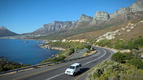 12 Apostles. SOUTH AFRICA - MARCH 18: in this time-lapse view cars drive in front of Twelve Apostles on March 18, 2010 in Cape Town, South Africa stock video