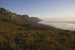 The 12 Apostles of Table Mountain tower above Camps Bay and Bakoven Royalty Free Stock Photos
