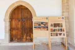 Apostolos Andreas monastery restoration description boards and r. Estored door. The historic Apostolos Andreas Monastery is located in the Karpasia peninsula Royalty Free Stock Photo