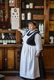 Apothecary at Blists Hill. TELFORD, UK - CIRCA 2013: An actor at Blists Hill Victorian Museum poses as a pharmacist in a traditional apothecary. Ironbridge, UK royalty free stock images