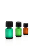 Apothecary Bottles. Three green apothecary bottles in different sizes and colors, over white background Stock Image