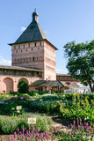Apothecary garden and main entrance tower of the Saviour Monastery of St. Euthymius, Russia, Suzdal royalty free stock images