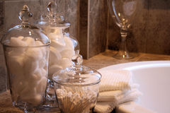 Apothecary Jars. Next to Spa Tub royalty free stock image