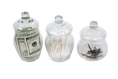 Apothecary Jars Filled with Money Stock Images