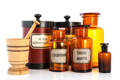 Apothecary pots with ingredients for medicins. Isolated over white background stock images