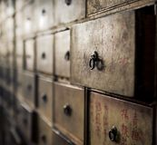 Apothecary asian drawers - retro furniture. Apothecary, ragged asian drawers - retro furniture stock photography