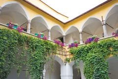 Medieval inner courtyard with arcades. Apothekerhaus or Körblerhaus inner courtyard, a medieval house in Judenburg with arcades on octagonal columns, partly Royalty Free Stock Images