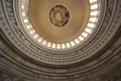 The Apotheosis of Washington. Is the immense fresco painted by Italian artist Constantino Brumidi in 1865 and visible through the oculus of the dome in the Royalty Free Stock Photo