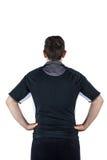 Apoye al jugador dado vuelta del rugbi con las manos en caderas imagen de archivo