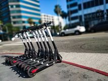 App based scooters lined up awaiting their next riders stock photos