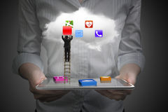 App blocks smart tablet with cloud and businessman climbing ladd Stock Image